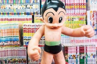 Это Astro Boy, наполовину человек, наполовину робот, персонаж манги, который сформировал идею андроидов в японской культуре.